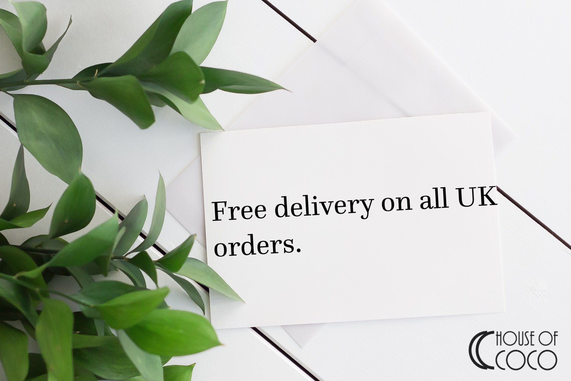 White background with green leaves and free delivery notice.